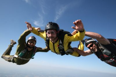aff skydiving student smiles in freefall