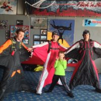 wingsuiters with kid in hangar at OSC