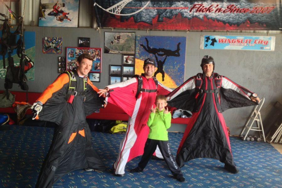 wingsuiters with kid in hangar at OSC